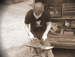 Horse shoe making on anvil